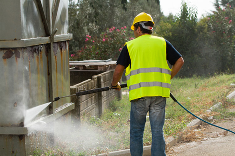 Man following pressure washer safety guidelines
