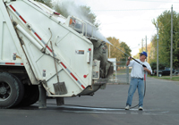 Garbage truck being pressure washed