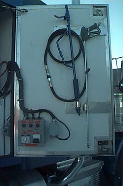 Pressure washer gun and control on inside of trailer door